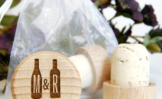 Personalized wine cork with two wine bottles, monogram, and wedding date.
